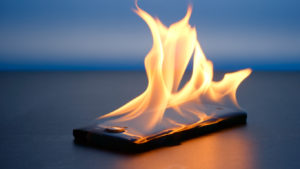 Smartphone lies and burning on a table in the night