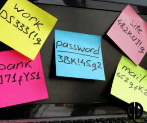 A computer screen covered in post-it notes with passwords written on them